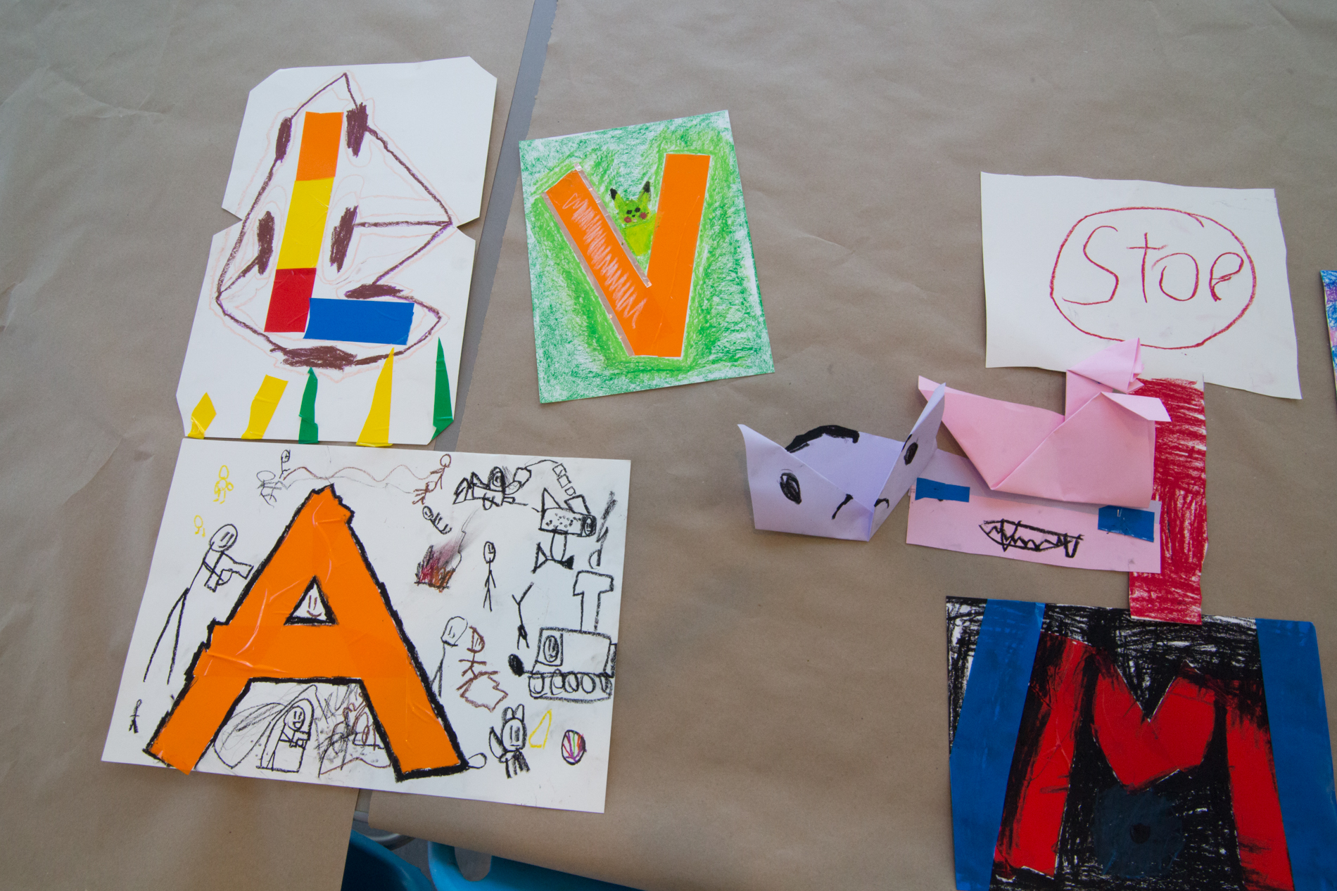 photo of kid's art crafts, initials on paper